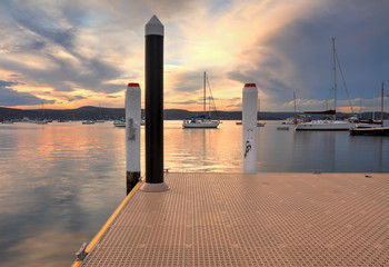 Boats and yachts moored at sunset