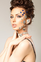 portrait of beautiful girl with diamonds on her face