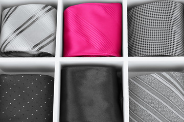 Concept of individuality.One bright color necktie among grey