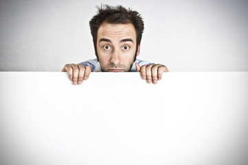 Man holding an empty white board