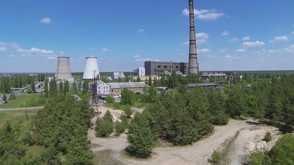 Up over Thermal power plant in  wood .Aerial