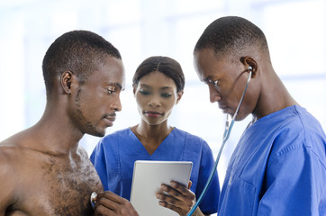 African Doctor with nurse and Patient