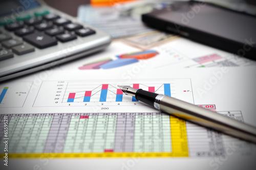Leinwanddruck Bild financial report on table