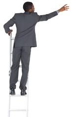 Businessman standing on ladder