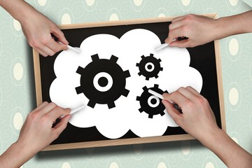 Composite image of multiple hands drawing cogs with chalk