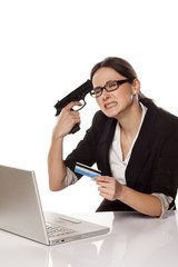 Desperate business woman with credit card and gun