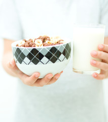Hands with milk and flakes