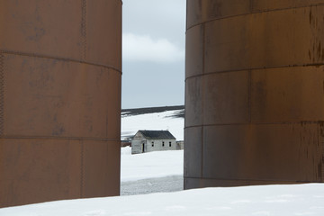 The tall sides of rusting metal whale oil tanks at the former whaling station on Deception Island.