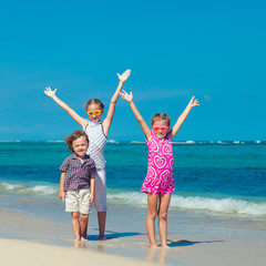 happy kids playing on beach in the day time
