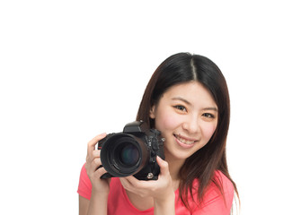 Pretty asian photographer girl happy shooting with her camera. I