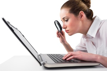 Attentive businesswoman typing on laptop