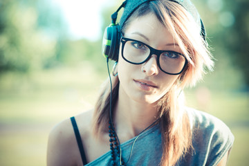 young beautiful model woman listening music
