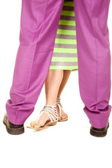 man woman legs close together green purple