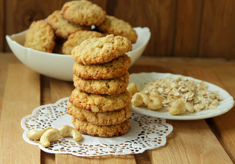 Freshly baked oatmeal cookies, stacked.