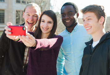 Group of diverse friends taking a selfie