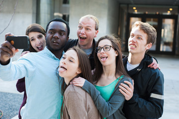 Group of Diverse Friends Taking a Goofy Selfie