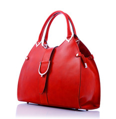 Red handbag on white background