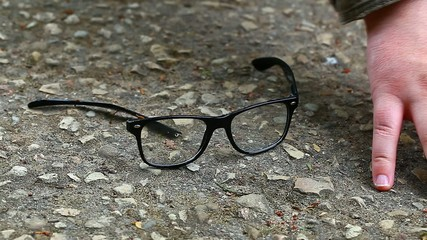 Man looking for fallen eyeglasses