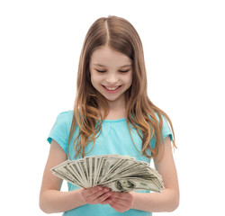 smiling little girl looking at dollar cash money