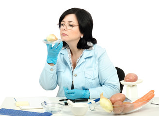 Inspector smelling onion in laboratory