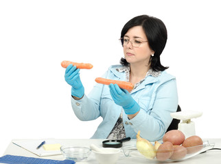 Inspector looking at two carrots in laboratory