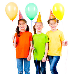 Three cute little girls with coloured balloons.