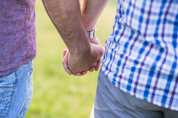 Gay couple holding hands outdoor