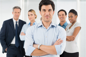Confident Businessman With Coworker
