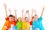 Fototapety Group of children in colored t-shirts with raised hands.