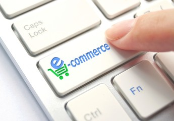 E-Commerce Button on Computer Keyboard. Internet Concept