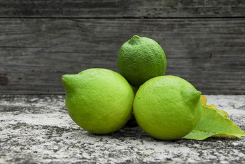 Three green lemons