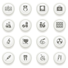 Medicine icons on gray buttons.