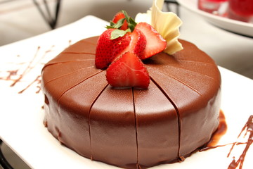 dark chocolate cake with fresh strawberry