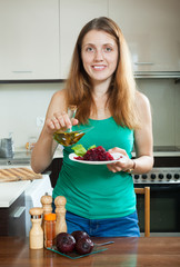 ordinary woman eating boiled beets