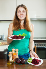 woman in green with  beets
