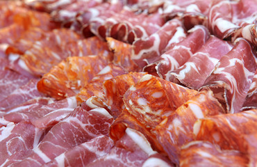 Display of spicy salami and ham on a buffet