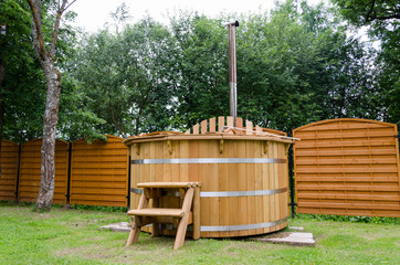 rural wooden water hot tub with stairs garden yard