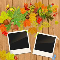 photo frame on wooden texture with autumn leaves
