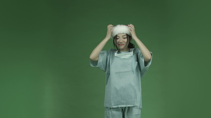 young asian adult woman doctor surgeon isolated on green-screen
