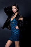 Luxury sexy girl in blue dress and fury coat  poster