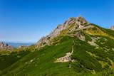 On a mountain trail in Tatra Mountains, Poland. - 65618247