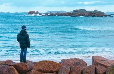 Boy and Tregastel coast view (Brittany, France)