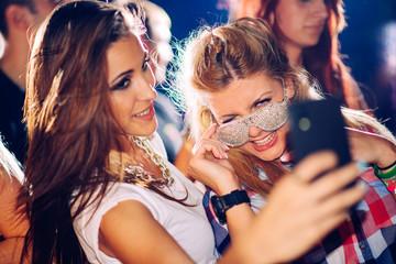 Party people taking selfie