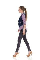 Fashion model walking in high heels