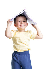 preschooler child with a book over his head isolated over white