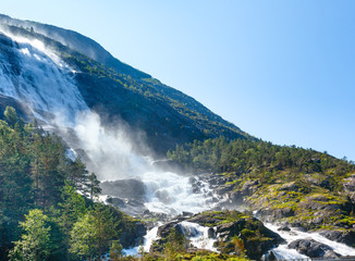 Summer Langfossen waterfall  (Norway).