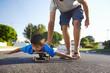 Leinwandbild Motiv father son skateboard