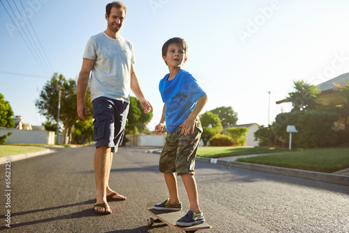 father son skateboard