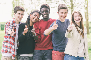 Multiethnic Group of Teenagers with Thumbs Up