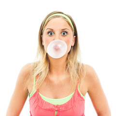 Woman blowing bubblegum bubble